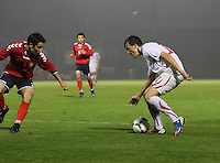 Albion Avdijaj running at Hakob Loretsyan in the Armenia v Switzerland UEFA European Under-19 Championship Qualifying Round match at New Douglas Park, Hamilton on 11.10.12.
