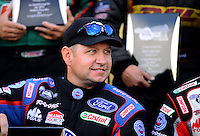 Sept. 14, 2012; Concord, NC, USA: NHRA funny car driver Robert Hight during qualifying for the O'Reilly Auto Parts Nationals at zMax Dragway. Mandatory Credit: Mark J. Rebilas-