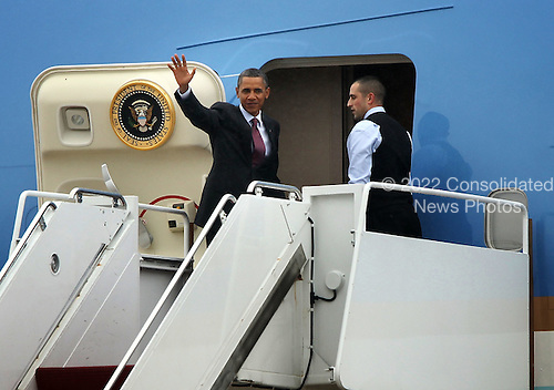 United States President Barack Obama waves at the top step of the Air Force One as he departs from Joint Base Andrews September 8, 2011 in Maryland. Obama was on his way to Richmond, Virginia to sell his job plan. .Credit: Alex Wong / Pool via CNP