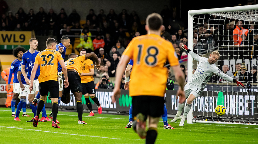 Leicester City's Kasper Schmeichel (right) is beaten by a header from Wolverhampton Wanderers' Willy Boly (centre) which was then ruled out by a VAR decision of offside <br /> <br /> Photographer Andrew Kearns/CameraSport<br /> <br /> The Premier League - Wolverhampton Wanderers v Leicester City - Friday 14th February 2020 - Molineux - Wolverhampton<br /> <br /> World Copyright © 2020 CameraSport. All rights reserved. 43 Linden Ave. Countesthorpe. Leicester. England. LE8 5PG - Tel: +44 (0) 116 277 4147 - admin@camerasport.com - www.camerasport.com