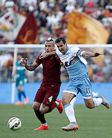 Calcio, Serie A: Lazio vs Roma. Roma, stadio Olimpico, 25 maggio 2015.<br /> Roma's Radja Nainggolan, left, is challenged by Lazio's Miroslav Klose during the Italian Serie A football match between Lazio and Roma at Rome's Olympic stadium, 25 May 2015.<br /> UPDATE IMAGES PRESS/Isabella Bonotto