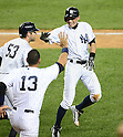 Ichiro Suzuki (Yankees),<br /> AUGUST 20, 2013 - MLB :<br /> Ichiro Suzuki of the New York Yankees celebrates with his teammates Austin Romine and Alex Rodriguez after scoring the game winning run in the ninth inning of the second game of their Major League Baseball doubleheader against the Toronto Blue Jays at Yankee Stadium in The Bronx, New York, United States. (Photo by AFLO)