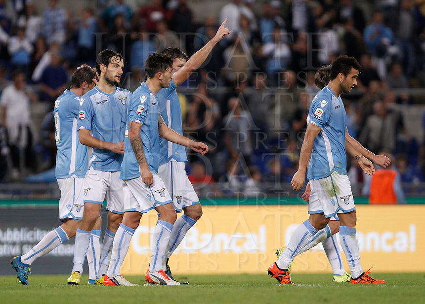 Calcio, Serie A: Lazio vs Frosinone. Roma, stadio Olimpico, 4 ottobre 2015.<br /> Lazio&rsquo;s Filip Djordjevic, second from right, celebrates with teammates after scoring during the Italian Serie A football match between Lazio and Frosinone at Rome's Olympic stadium, 4 October 2015.<br /> UPDATE IMAGES PRESS/Isabella Bonotto