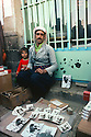 Iran 1979.A man selling pictures of Kurdish personalities in the street of Mahabad