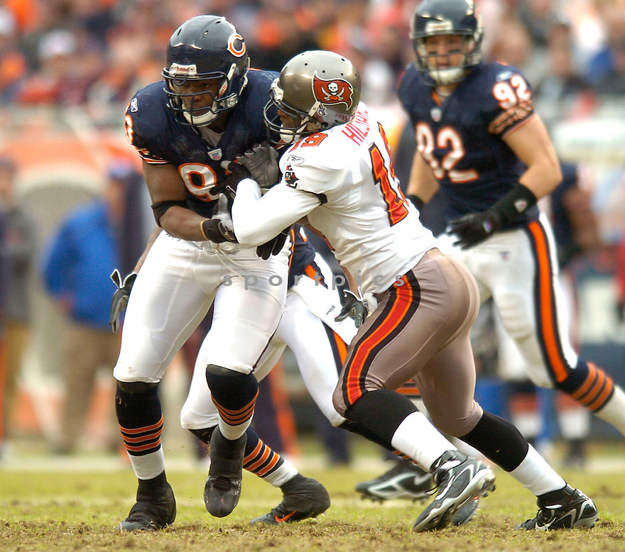 ADEWALE OGUNLEYE, of the Chicago Bears, during their game  against the Tampa Bay Buccaneers on December 17, 2006 in Chicago, IL...Bears wins 34-31...DAVID DUROCHIK / SPORTPICS