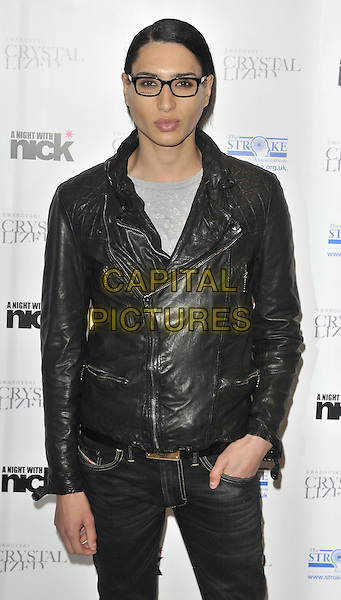 "Natt Weller.The ""A Night With Nick"" charity event in aid of The Stroke Association, Swarovski CRYSTALLIZED, Gt. Marlborough St., London, England..December 6th, 2011.half length black leather jacket glasses hand in pocket .CAP/CAN.©Can Nguyen/Capital Pictures."