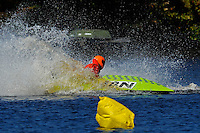 Frame 8: 24-J and 48-N  race into the turn, 48-N then catches the wake a spins out at speed. (runabout)