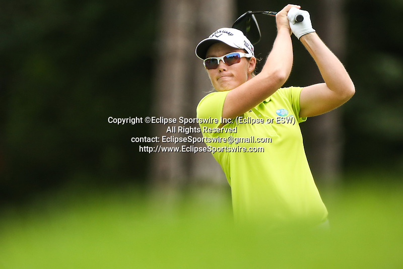 Stacey Keating tees off on the 9th tee at the LPGA Championship 2014 Sponsored By Wegmans at Monroe Golf Club in Pittsford, New York on August 16, 2014
