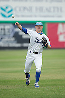 Burlington Royals starting pitcher Nolan Watson (23) warms up in the outfield prior to the game against the Bluefield Blue Jays at Burlington Athletic Park on July 1, 2015 in Burlington, North Carolina.  The Royals defeated the Blue Jays 5-4. (Brian Westerholt/Four Seam Images)