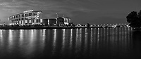 Another capture in black and white of the McLane Stadium with the building and pedestrian bridge in a pano with the lights on against a twilight blue hour sky with with clouds left over from sunset for a stunning look. The Brazos river capture some nice reflections from the lights of the McLane Stadium where the Baylor University Bears play their games. We capture this as a panorama so you can also see the the pedestrian bridge that crosses over the Brazos river in this panorama.