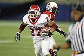 January 5th, 2008:  Rutgers Ray Rice (27) breaks the tackle of Ball State defender Eddie Burk (1) on a 90 yard touchdown run during the third quarter of the International Bowl at the Rogers Centre in Toronto, Ontario Canada...Rutgers defeated Ball State 52-30.  ..Photo By:  Mike Janes Photography