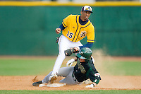 Corey Shaylor #12 of the Charlotte 49ers slides into second base under the tag from James Howard #15 of the North Carolina A&T Aggies at War Memorial Stadium March 23, 2010, in Greensboro, North Carolina.  Photo by Brian Westerholt / Four Seam Images