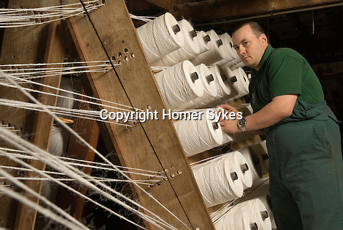 Mark Smith is Ropier at The Historic Dockyard Chatham Kent. Mark is using two hundred year old machinery and seen here with 18 mm rope thats coming off 'cops' ( bobbins) before being fed through the registration plates and then 'forming tubes' to become 2.25 inch diameter rope.