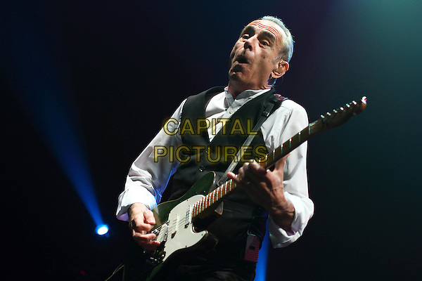 Status Quo - Francis Rossi .performing live in concert, Moscow, Russia, 15th April 2010..music gig on stage half length black waistcoat white shirt guitar playing mouth open funny face .CAP/PER/SB.©SB/PersonaStars/Capital Pictures.