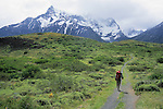 A young woman hikes along a trail in Torres del Paine National Park, Chile.