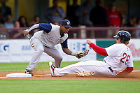 Lars Anderson #26 of the Pawtucket Red Sox slides into third base ahead of the tag by Gookie Dawkins #9 of the Charlotte Knights at McCoy Stadium on June 14, 2011 in Pawtucket, Rhode Island.  The Knights defeated the Red Sox 4-2 in 11 innings.    Photo by Brian Westerholt / Four Seam Images