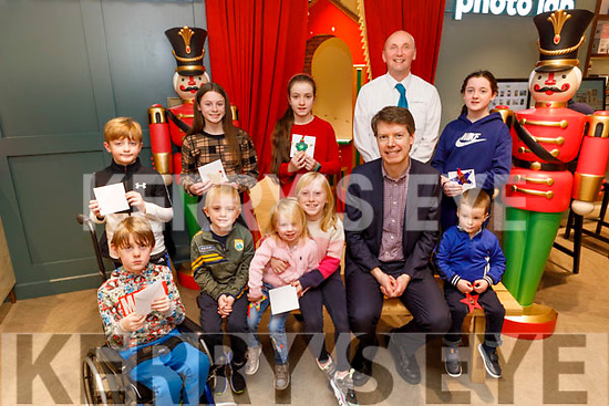 Winners of the CH Chemist Santaland colouring competition, pictured in the store on Saturday.<br /> Front l to r: Shane Enright, Eoin, Erin and Ava Flaherty, Peter Harty (CH Chemist) and Jamie Ellard.<br /> Back l to r: Mark Riordan, Aoibhinn Ferris, Esther Tyther, Kevin O'Riordan (CH Chemist) and Emma Goarse