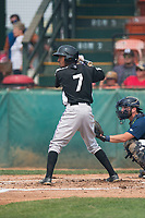 Grand Junction Rockies shortstop Cristopher Navarro (7) at bat in front of catcher David Fry (5) during a Pioneer League game against the Helena Brewers at Kindrick Legion Field on August 19, 2018 in Helena, Montana. The Grand Junction Rockies defeated the Helena Brewers by a score of 6-1. (Zachary Lucy/Four Seam Images)