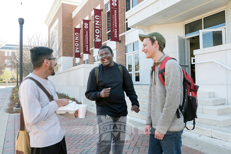 Students outside Colvard Union - friends Osvaldo Ballesteros Garcia, Quincy Parker, Greg Martin.<br />  (photo by Megan Bean / &copy; Mississippi State University)