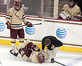 Johnny Gaudreau (BC - 13), Bill Arnold (BC - 24), Bert Lenz (BC - Director, Sports Medicine) - The Boston College Eagles defeated the visiting University of Vermont Catamounts to sweep their quarterfinal matchup on Saturday, March 16, 2013, at Kelley Rink in Conte Forum in Chestnut Hill, Massachusetts.