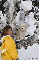 Mother with her family dog in a tree in winter