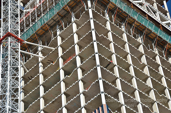 Core of an office tower building under construction showing individual floors