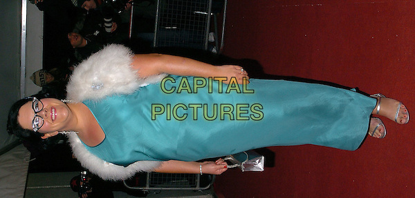 "AMY LAME.Arrives for ITV's ""An Audience with Al Murray"" TV Programme, London, Fwbruary 6th 2005..full length turquoise dress fur cap stole shawl wrap glasses.Ref: CAN.www.capitalpictures.com.sales@capitalpictures.com.©Capital Pictures."
