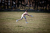 Boy catching a frisbee during free activities.