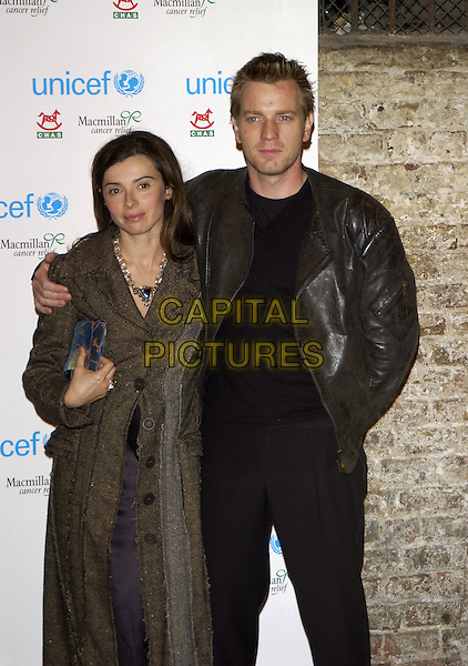 EVE McGREGOR & EWAN McGREGOR.At the Long Way Round Party & Photocall fundraiser in aid of UNICEF, Children's Hospice of Scotland (CHAS) and Macmillan Cancer Relief, at The Bridge, London,.October 12th 2004..half length leather jacket tweed coat married wife husband.Ref: PL.www.capitalpictures.com.sales@capitalpictures.com.©Capital Pictures.