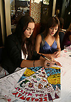 Marnie Schulenberg - ATWT and Ewa Da Cruz signs poster at the 22nd Annual Broadway Flea Market and Grand Auction to benefit Broadway Cares / Equity Fights Aids on Sunday 21, 2008 in Shubert Alley, New York City, NY. (Photo by Sue Coflin/Max Photos)