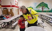 NWA Democrat-Gazette/BEN GOFF @NWABENGOFF<br /> Carlos Pedroza, a 2nd grade student, gives Randy Harvey, Lowell police chief, a hug Friday, March 9, 2018, at Lowell Elementary. Harvey acts as crossing guard at the school before spending time visiting with staff and students each morning.