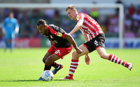 Swindon Town's Keshi Anderson shields the ball from Lincoln City's Scott Wharton<br /> <br /> Photographer Chris Vaughan/CameraSport<br /> <br /> The EFL Sky Bet League Two - Lincoln City v Swindon Town - Saturday 11th August 2018 - Sincil Bank - Lincoln<br /> <br /> World Copyright &copy; 2018 CameraSport. All rights reserved. 43 Linden Ave. Countesthorpe. Leicester. England. LE8 5PG - Tel: +44 (0) 116 277 4147 - admin@camerasport.com - www.camerasport.com