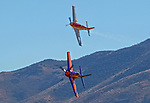 "Stewart Dawson flying Rare Bear, bottom, races Robert ""Hoot"" Gibson, flying his P-51D Mustang Strega in Unlimited Class during the National Championship Air Races at the Reno-Stead Airfield Friday, Sept. 18, 2015."
