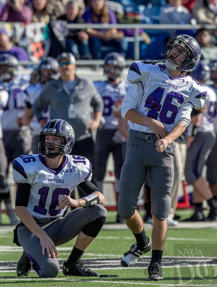 STAFF PHOTO JASON IVESTER --12/06/2014--<br /> Fayetteville junior Jack Lindsey (left) and senior kicker Cal Conway watch as Conway's field goal attempt misses against Bentonville in the 7A championship game on Saturday, Dec. 6, 2014, at War Memorial Stadium in Little Rock. More photos at nwaonline.com/photos.