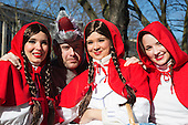 Düsseldorf, Germany. 15 February 2015. The Little Red Riding Hoods with the Big Bad Wolf. Street carnival celebrations take place on Königsallee (Kö) in Düsseldorf ahead of the traditional Shrove Monday parade (Rosenmontagszug).