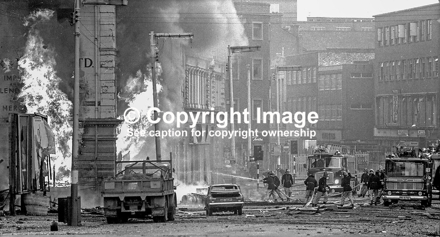 Firemen tackle blaze following Provisional IRA 500 lb bomb attack on the RUC police station, Musgrave Street, Belfast, N Ireland. Adjacent buildings seemed to have suffered more damage than the actual police station. It was claimed the bomb attack was in retaliation for the death of IRA member Hugh Coney who was shot dead by a sentry during an escape attempt at the Maze Prison. Twenty nine other prisoners were captured within a few yards of the prison, and the remaining three were back in custody within 24 hours. 1974110604a.<br />