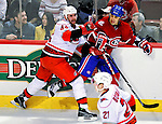 31 March 2010: Carolina Hurricanes' defenseman Jay Harrison checks Montreal Canadiens center Scott Gomez in the first period at the Bell Centre in Montreal, Quebec, Canada. The Hurricanes defeated the Canadiens 2-1 in their last meeting of the regular season. Mandatory Credit: Ed Wolfstein Photo