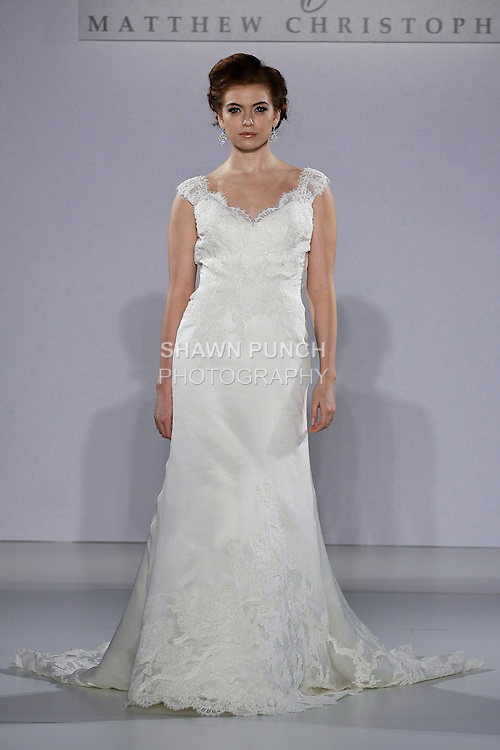 Model walks runway in a Flora wedding dress from the Matthew Christopher Couture Spring 2013 collection, at the Couture Show, during New York Bridal Fashion Week Spring 2013.