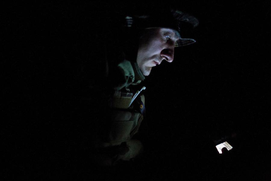 UKRAINE, Pisky: Vladimir, in the trenches of the frontline, is trying to reach is commander by phone as his radio is not working.<br /> <br /> UKRAINE, Pisky: Vladimir, dans les tranch&eacute;es de premi&egrave;re ligne, essaie d'atteindre son commandant par t&eacute;l&eacute;phone que sa radio ne fonctionne pas.