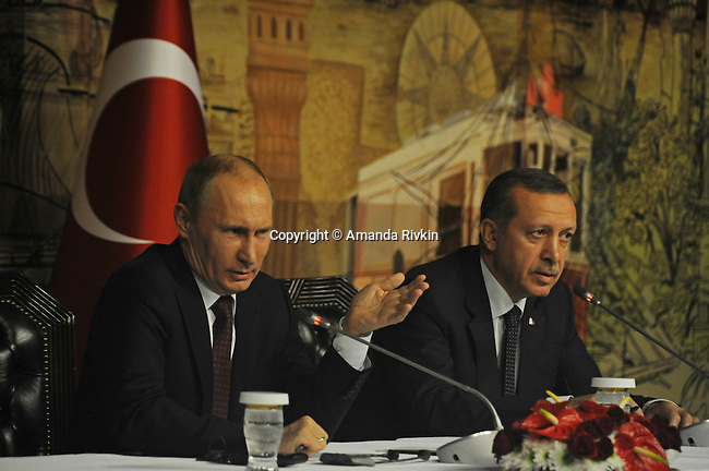 Russian President Vladimir Putin and Turkish Prime Minister Recep Tayyip Erdogan are seen at a joint press conference at the Turkish Prime Minister's office at Dolmabahce Palace in Istanbul, Turkey on December 3, 2012.