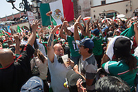 Los Angeles, CA -  Monday, June 23, 2014: Hundreds of Mexico fans  cheer a Mexico goal while watching the Mexico vs. Croatia first round match at a public viewing at Plaza Mexico.