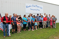 MEGAN DAVIS/MCDONALD COUNTY PRESS On Tuesday, June 3, friends, family, and members of the McDonald County Chamber of Commerce gathered to celebrate as TC Banta cut the ribbon of Banta's Deal Depot in Pineville. The depot is a one-stop shop for discounted goods of a wide variety.