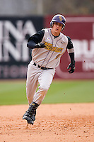 Jamie Ray (4) of the East Carolina Pirates hustles into third base with a triple at Sarge Frye Field in Columbia, SC, Sunday, February 24, 2008.