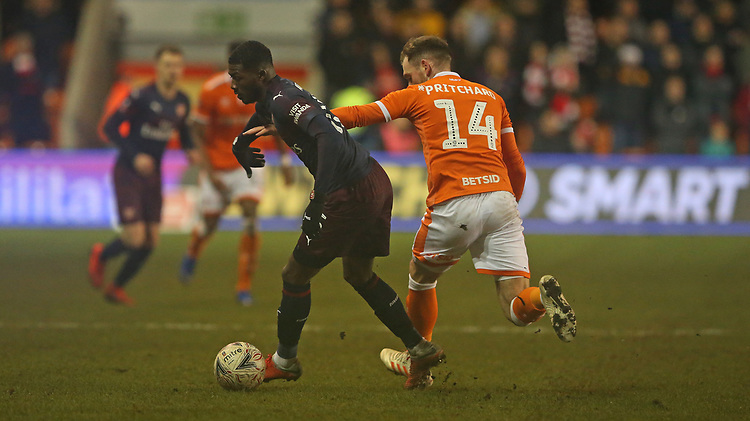 Arsenal's Ainsley Maitland-Niles shields the ball from Blackpool's Harry Pritchard<br /> <br /> Photographer Stephen White/CameraSport<br /> <br /> Emirates FA Cup Third Round - Blackpool v Arsenal - Saturday 5th January 2019 - Bloomfield Road - Blackpool<br />  <br /> World Copyright &copy; 2019 CameraSport. All rights reserved. 43 Linden Ave. Countesthorpe. Leicester. England. LE8 5PG - Tel: +44 (0) 116 277 4147 - admin@camerasport.com - www.camerasport.com