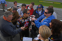 Feb 11, 2007; Daytona, FL, USA; Nascar Nextel Cup driver Juan Pablo Montoya (42) is interviewed by the media during qualifying for the Daytona 500 at Daytona International Speedway. Mandatory Credit: Mark J. Rebilas