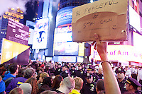 "Protesters with ""Occupy Wall Street"" are blocked by barricades in Times Square on October 15, 2011 in New York City.  While crowd estimates numbered in the tens of thousands, police tactics (including nets, motor scooters, barricades, arrests, and intimidation by riders on horseback) prevented the crowd, which had been split up, from joining together as one in the middle of Times Square."