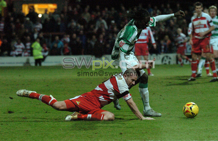 Pix: Howard Roe/SWpix.com. Football, Coca Cola League 1, Doncaster Rover v Yeovil Town 02/01/06..copyright picture>>simon wilkinson>>07811267706>>..Yeovil's Kevin Amankwah wins the challenge on Rovers Mark Allbrighton