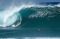 Surfer getting barreled on Big Wave at Pipeline on the North Shore of Oahu