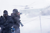 Members of the media turn away from the blowing snow as Marine One comes in for a landing on the snow covered South Lawn of the White House in Washington, District of Columbia, U.S., on Wednesday, Jan. 7, 2015.  United States President Barack Obama is traveling to the Ford Michigan Assembly Plant in Wayne, Michigan to deliver remarks highlighting the workers in the resurgent American automotive and manufacturing sector now that the auto rescue has been completed and the decision to save the auto industry and the over one million jobs that went with it. <br /> Credit: Pete Marovich / Pool via CNP