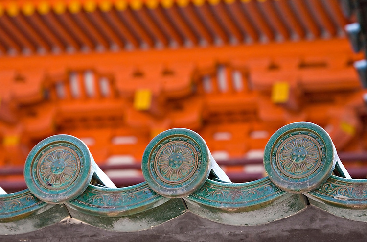 Detail of circular family crest tiles at Heian-Jingu Shrine in Kyoto Japan